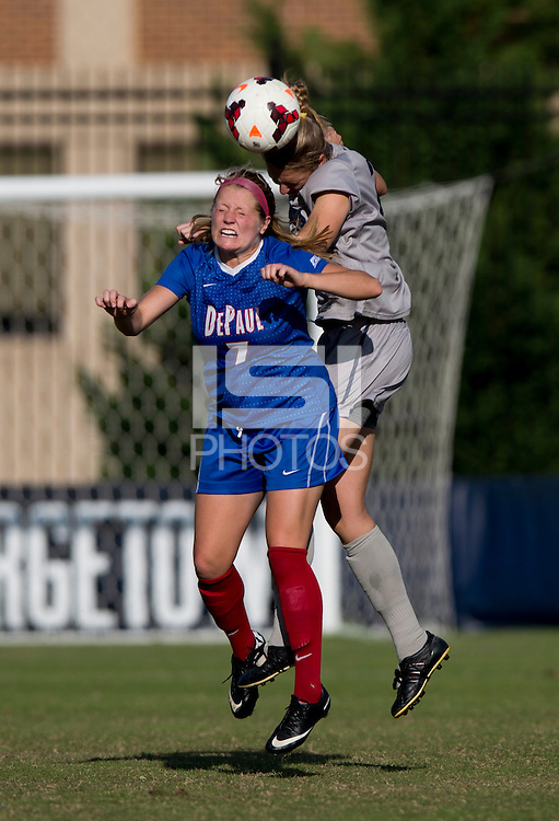 Mary Kroening (21) of Georgetown goes up for a header with Elise Wyatt (7) of DePaul during the game at Shaw Field on the campus of Georgetown University in Washington, DC.  Georgetown tied DePaul, 1-1, in double overtime.