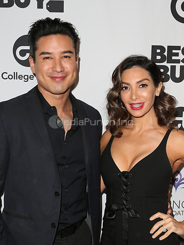 LOS ANGELES, CA - NOVEMBER 8: Mario Lopez, Courtney Laine Mazza, at the Eva Longoria Foundation Dinner Gala honoring Zoe Saldana and Gina Rodriguez at The Four Seasons Beverly Hills in Los Angeles, California on November 8, 2018. Credit: Faye Sadou/MediaPunch