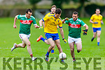 Ballymacs Tomas O'Connor under pressure from Brian Smith and James Moran of St Michaels Foilmore in the Junior Club Champipnship
