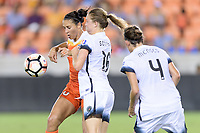 Houston, TX - Saturday July 08, 2017: Carli Lloyd and Emily Sonnett battle for control of the ball during a regular season National Women's Soccer League (NWSL) match between the Houston Dash and the Portland Thorns FC at BBVA Compass Stadium.