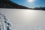 Footprints in the snow on frozen Pocantico Lake, Westchester, New York
