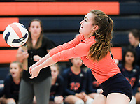 NWA Democrat-Gazette/CHARLIE KAIJO Rogers Heritage High School Brittney Ware (4) digs during a volleyball game, Thursday, October 11, 2018 at Rogers Heritage High School in Rogers.