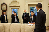 Washington, DC - October 14, 2009 -- United States President Barack Obama holds a briefing with Tina Tchen, Director of the Office of Public Engagement, right, and staff in the Oval Office, prior to the Asian American and Pacific Islander Initiative Executive Order signing, and Diwali festival of lights ceremony at the White House, October 14, 2009. .Mandatory Credit: Pete Souza - White House via CNP