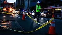 NEW YORK, NEW YORK - JULY 13: A Con Edison worker checks some power lines during a major power outage on July 13, 2019 in New York City. New Yorkers are without power as a major outage left portions of Manhattan, including Times Square and the Upper West Side with disrupting subway service across the city. (Photo by VIEWPRESS)