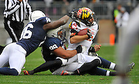 01 November 2014:  Penn State DE C.J. Olaniyan (86) and DT Austin Johnson (99) sack Maryland QB C.J. Brown (16). The Maryland Terrapins defeated the Penn State Nittany Lions 20-19 at Beaver Stadium in State College, PA.