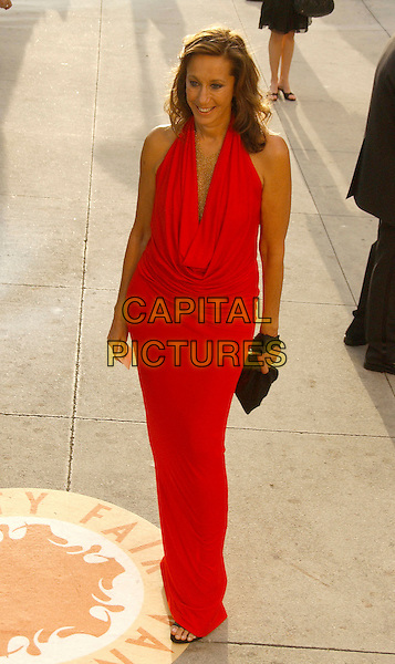 DONNA KAREN.The 2007 Vanity Fair Oscar Party Hosted by Graydon Carter held at Morton's, West Hollywood, California, USA,.25 February 2007..full length red dress.CAP/ADM/GB.©Gary Boas/AdMedia/Capital Pictures.