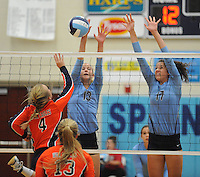 NWA Democrat-Gazette/ANDY SHUPE<br /> Lindsay Glynn (4) of Rogers Heritage sends the ball over the net as Elizabeth Williams (13) and Jaden Williams (17) of Springdale Har-Ber reach to block Thursday, Sept. 17, 2015, at Wildcat Arena in Springdale. Visit nwadg.com/photos to see more photographs from the game.