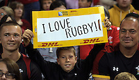 """Pictured: A young Wales supporter holding a """"I love rugby"""" banner Sunday 20 September 2015<br />Re: Rugby World Cup 2015, Wales v Uruguay at the Millennium, Stadium, Wales, UK"""