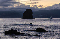 WQ70621-D. Lava rocks in the shallows just offshore Pico Island, looking across at Faial Island. Azores, Portugal, Atlantic Ocean.<br /> Photo Copyright © Brandon Cole. All rights reserved worldwide.  www.brandoncole.com