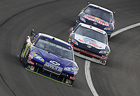 Feb 22, 2009; Fontana, CA, USA; NASCAR Sprint Cup Series driver David Gilliland leads Scott Riggs and Brian Vickers during the Auto Club 500 at Auto Club Speedway. Mandatory Credit: Mark J. Rebilas-