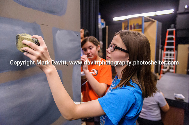 Paige Hollingshead and Karlee Krier paint a set for Southeast Polk High School's Beauty and the Beast to be presented Nov. 11 at 7 p.m. and Nov. 12 at 7 p.m. In addition, on Nov. 12 at 10–11:30 a.m. The players will host a VIP Enchanted Event in which  guests can meet Bell, the Beast, and other characters.