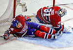 31 March 2010: Montreal Canadiens' defenseman Roman Hamrlik (44) slides into the goalpost during the first period of play against the Carolina Hurricanes at the Bell Centre in Montreal, Quebec, Canada. The Hurricanes defeated the Canadiens 2-1. Mandatory Credit: Ed Wolfstein Photo