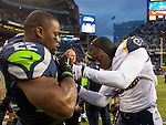 St. Louis Rams  defensive back Maurice Alexander (31) helps Seattle Seahawks running back Robert Turbin (22) undo the shoulder pad straps after their game  at CenturyLink Field in Seattle, Washington on December 28, 2014.  The Seahawks officially wrapped up the No. 1 seed in the NFC playoffs shortly after beating the Rams, 20-6. Despite the Cowboys and Packers also winning to finish 12-4, the Seahawks (12-4) won the multi-team tiebreaker and earned home-field advantage throughout the playoffs for the second consecutive season.  ©2014. Jim Bryant Photo. All Rights Reserved.