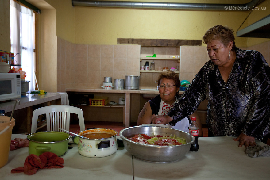 Paola (L) and Lourdes (R), both residents of Casa Xochiquetzal, during lunch time at the shelter in Mexico City, Mexico on October 4, 2010. Casa Xochiquetzal is a shelter for elderly sex workers in Mexico City. It gives the women refuge, food, health services, a space to learn about their human rights and courses to help them rediscover their self-confidence and deal with traumatic aspects of their lives. Casa Xochiquetzal provides a space to age with dignity for a group of vulnerable women who are often invisible to society at large. It is the only such shelter existing in Latin America. Photo by Bénédicte Desrus