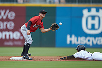 Kevin Kramer (17) of the Indianapolis Indians waits for the throw as Jacob May (8) of the Charlotte Knights slides head-first into second base at BB&T BallPark on August 22, 2018 in Charlotte, North Carolina.  The Indians defeated the Knights 6-4 in 11 innings.  (Brian Westerholt/Four Seam Images)