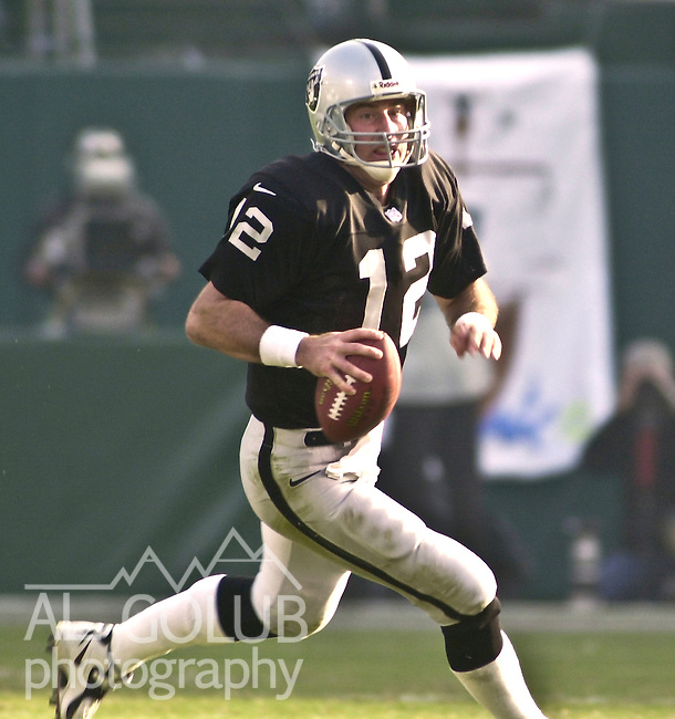 Oakland Raiders vs. Miami Dolphins at Oakland Alameda County Coliseum Saturday, January 6, 2001.  Raiders beat Dolphins  27-0.  Oakland Raiders quarterback Rich Gannon (12).