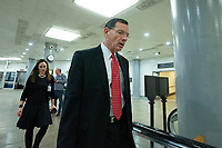 United States Senator John Barrasso (Republican of Wyoming) walks through the Senate Subway during a cloture vote on a Coronavirus Stimulus Package at the United States Capitol in Washington D.C., U.S., on Monday, March 23, 2020.  Credit: Stefani Reynolds / CNP/AdMedia
