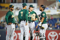 Lynchburg Hillcats relief pitcher Luke Eubank (11) talks with catcher Juan De La Cruz (43) and manager Mark Budzinski (7) as Bobby Bradley (44) listens during a game against the Wilmington Blue Rocks on June 3, 2016 at Judy Johnson Field at Daniel S. Frawley Stadium in Wilmington, Delaware.  Lynchburg defeated Wilmington 16-11 in ten innings.  (Mike Janes/Four Seam Images)