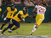 D.J. Holt of California tries to tackle Boomer Roepke of USC during the game at AT&T Park in San Francisco, California on October 13th, 2011.  USC defeated California, 30-9.