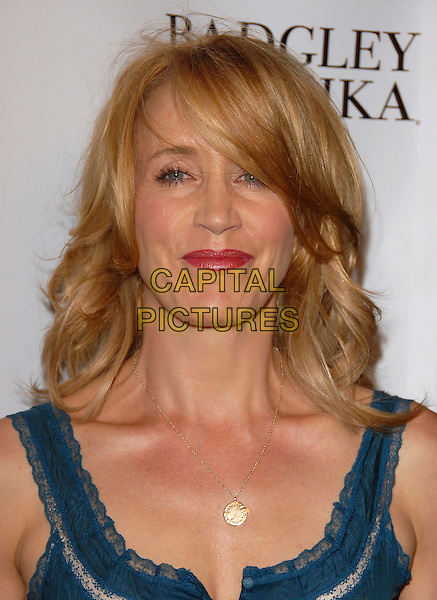 FELICITY HUFFMAN.attend The New Badgley Mischka Campaign, held at One Sunset Restaurant in West Hollywood, California, USA, August 27th 2007.                                                              portrait headshot fringe hair over face  red lipstick.CAP/DVS.©Debbie VanStory/Capital Pictures