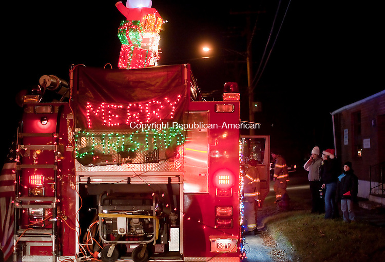 WINSTED, CT--- -121915JS04--Fire trucks line Meadow Street in Winsted as they stage prior to the 11th annual Winsted Fire Department &quot;Gator&quot; Christmas Parade on Saturday. The parade continues to honor the tradition of former firefighter Gaeton &quot;Gator&quot; Gangi who started the parade in 2004 as a community Christmas parade. <br /> Jim Shannon Republican-American