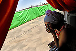 An Eritrean woman at the window of her caravan room, in a women-children detention facility within Ketziot Prison compound, designated for African asylum-seekers who have illegally crossed the nearby Egyptian-Israeli border.