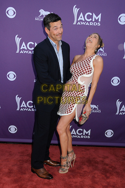 Eddie Cibrian, LeAnn Rimes.47th Annual Academy of Country Music Awards held at the MGM Grand, Las Vegas, Nevada, USA..April 1st, 2012.full length black suit blue shirt white red maroon burgundy one shoulder sheer dress arms around waist bending leaning mouth open laughing funny couple polka dot print pattern ACM CMA.CAP/ADM/BP.©Byron Purvis/AdMedia/Capital Pictures.