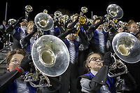 NWA Democrat-Gazette/CHARLIE KAIJO Fayetteville High School marching band members practice during a playoff football game on Friday, November 10, 2017 at Fayetteville High School in Fayetteville.