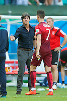 Germany manager Joachim Low shakes hands with Cristiano Ronaldo of Portugal after the match