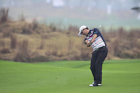 Felipe Aguilar (CHI) plays his 2nd shot on the 14th hole during Friday's Round 2 of the 2014 BMW Masters held at Lake Malaren, Shanghai, China 31st October 2014.<br /> Picture: Eoin Clarke www.golffile.ie