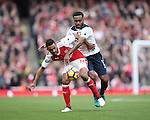 Arsenal's Theo Walcott tussles with Tottenham's Danny Rose during the Premier League match at the Emirates Stadium, London. Picture date November 6th, 2016 Pic David Klein/Sportimage