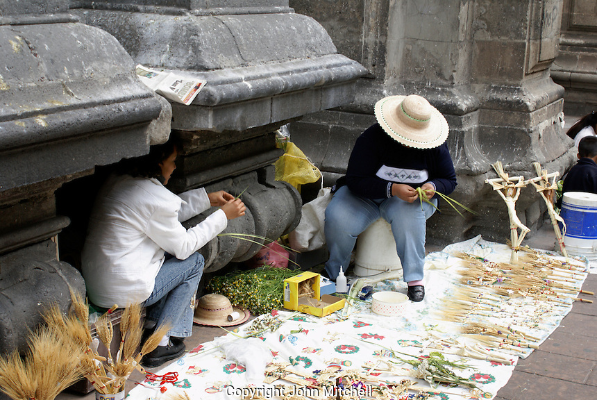 Women making Palm Sunday crosses outside a church in Mexico City