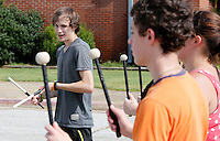 NWA Democrat-Gazette/DAVID GOTTSCHALK  Daken (cq) Bailey, a senior at Greenland High School, keeps time for a line during the Greenland High School Band practice Thursday, August 6, 2015 at the school. The 42 member band under the direction of Jeremy Doss is preparing the fall pep rallies, football half time performances and competitions taking place this fall.