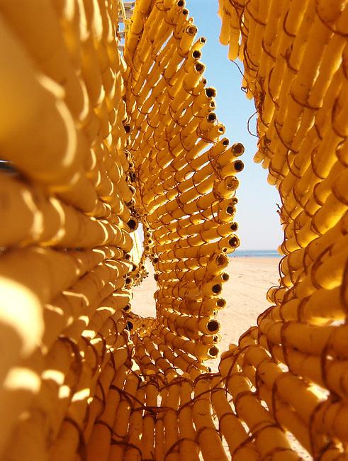1er Premio VIII Concurso de Fotograf&iacute;a de Arquitectura <br /> Contempor&aacute;nea, organizado por el Colegio Oficial de Arquitectos de Huelva.  2007<br /> Secci&oacute;n I: Fotograf&iacute;a Tradicional de la provincia de Huelva.<br /> Descripci&oacute;n: persiana de ca&ntilde;as en un chiringuito en La Antilla (Huelva) /<br /> 1st prize VIII Contemporary Architecture Photography Competition, organized by the Huelva Architectural Association COAH. 2007. Section I.<br /> Location: La Antilla (Huelva) Spain
