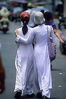 Two girls in traditional Ao Dai dresses and bucket hats, Saigon, Ho Chi Minh City, Vietnam