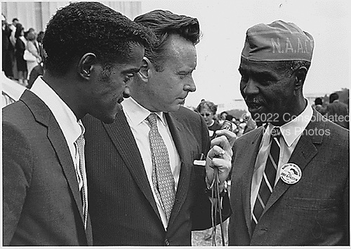 Sammy Davis, Jr., actor and performer, left, and Roy Wilkins, Executive Secretary of the National Association for the Advancement of Colored People, right, are interviewed by an unidentified reporter, center,  at 1963 March on Washington for Jobs and Freedom the Washington, D.C. , August 28, 1963.  This is the march where Dr. Martin Luther King, Jr. gave his &quot;I have a Dream&quot; speech.<br /> Credit: National Archives via CNP