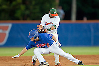 June 12, 2010:    Florida Outfielder Daniel Pigott (8) is tagged out by Miami Infielder Frankie Ratcliff (19) in a run down between first and second base during game two of NCAA Gainesville Super Regional action between the University of Florida Gators and Miami Hurricanes at Alfred A. McKethan Stadium on the campus of University of Florida in Gainesville.   Florida defeated Miami in 10 innings 4-3 to advance to the College World Series in Omaha, Nebraska...........
