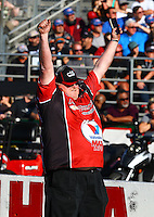 Feb 8, 2015; Pomona, CA, USA; Crew member Allan Lindsey react to a win recorded by NHRA pro stock driver Drew Skillman during the Winternationals at Auto Club Raceway at Pomona. Mandatory Credit: Mark J. Rebilas-