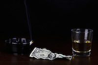 """The """"Last Dollar"""" portrays the end a long night at a bar with a glass of whiskey and a cigarette to end the night. Taken at my studio in Belton, Missouri on November 4, 2007"""