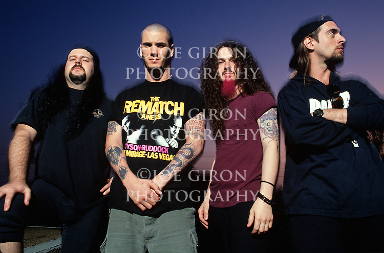 Various portraits & live photographs of the rock band, Pantera. Dimebag Darrell Abbott (Guitar), Philip Anselmo (Vocals), Rex Brown (Bass) & Vinnie Paul (Drums).