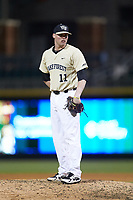 Wake Forest Demon Deacons relief pitcher Shane Muntz (11) looks to his catcher for the sign against the Charlotte 49ers at BB&T BallPark on March 13, 2018 in Charlotte, North Carolina.  The 49ers defeated the Demon Deacons 13-1.  (Brian Westerholt/Four Seam Images)