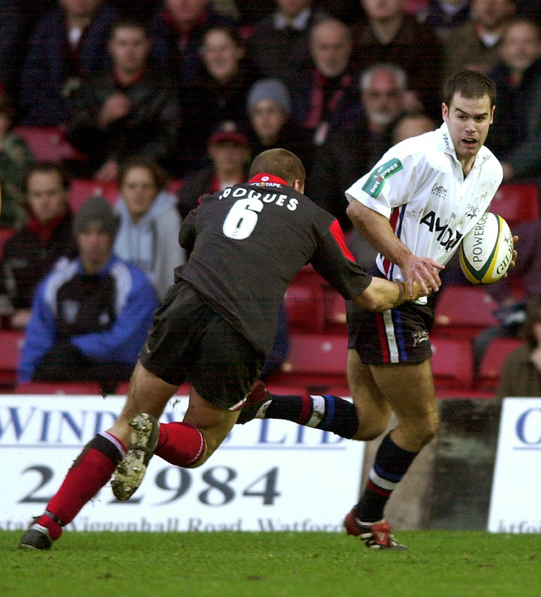 Photo. Richard Lane.Saracens v Sale Sharks at Vicarage Road. Powergen Cup. 22-12-2002.Charlie Hodgson is tackled by Tony Roques.