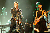 DAVID BOWIE (8 Jan 1947 - 10 Jan 2016) - performing live with bassist Gail Ann Dorsey on his last live performance in the UK as the headline act on Day 3 at the 2004 Isle of Wight Festival held in Newport, IoW, UK - 13 June 2004. Photo by: George Chin/IconicPix