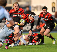 Hendon, England. Ben Spencer of Saracens charges forward  during the LV= Cup match for the first professional rugby game on the artificial turf pitch made for rugby between Saracens and Cardiff Blues at Allianz Park Stadium on January 27, 2013 in Hendon, England.