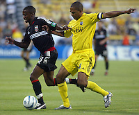 D.C. United's Jamil Walker (left) gets past Columbus Crew's Robin Fraser (right) during their game in Columbus, Ohio, Saturday, July 2, 2005.
