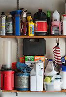 Product storage on a garage shelf.