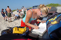 News///Turtle Huber///Rebecca Huber records information after digging up some turtle eggs for research. Rebecca is the one to have discovered the rare Kemp's ridley nest on Cape Lookout seashore. PHOTO BY CHUCK BECKLEY
