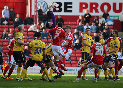 25.03.2016. Oakwell,  Barnsley, England.  Skybet League One Barnsley versus Scunthorpe Mar 25th. Scunthorpe's keeper Luke Daniels claws the ball away from pressure