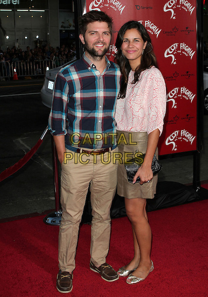 "ADAM SCOTT & NAOMI SABLAN.""Scott Pilgrim Vs. The World"" Los Angeles Premiere held at The Grauman;s Chinese Theatre, Hollywood, CA, USA..July 27th, 2010.full length beige brown trousers blue check shirt pink top skirt married husband wife beard facial hair .CAP/ADM/KB.©Kevan Brooks/AdMedia/Capital Pictures."