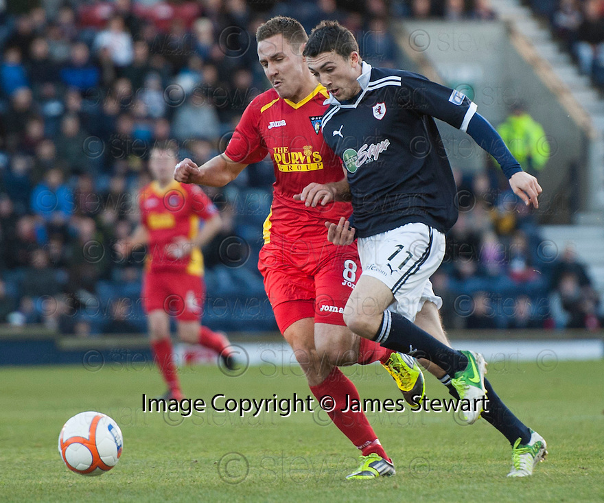 Pars' Stephen Husband and Raith's Pat Clarke challenge for the ball  ...
